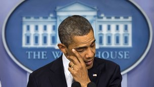 President Obama wipes away a tear while he talks about the Sandy Hook School shooting