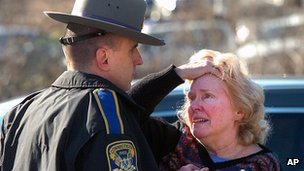 An upset woman talking to a police officer near Sandy Hook school
