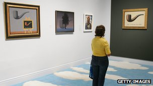 An art lover admires Magritte's 'Ceci n'est pas une pipe' at an exhibition in California