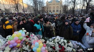 Flowers at the Solovetsky Stone in Moscow&#039;s Lubyanka Square. 15 Dec 2012