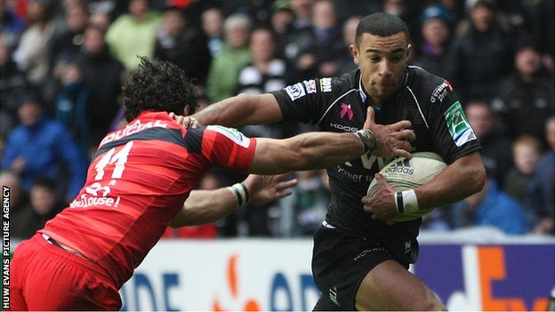 Ospreys wing hands off Yoann Huget of Toulouse to score