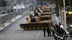 Tanks stand outside the presidential palace in Cairo, 15 December