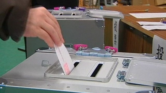 Voting paper going into ballot box