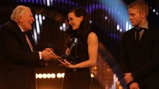 Sir Roger Bannister hands the BBC Sports Personality Team of the Year award to Victoria Pendleton