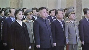 Screen grab from North Korean television shows Kim Jong-un and his wife at the memorial palace on 17 December 2012