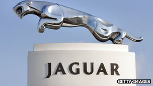 A Jaguar sign stands at a Jaguar dealership in the USA