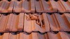 Yogi lying on terracotta tiles by artist LN Tallur