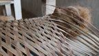 Exhibit made from coconut husk, coir, clay and metal scrap by Kerala-based artist Valsom Koorma Koller