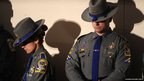 Connecticut State Troopers bow their heads