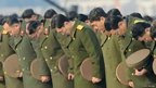 North Korean military officials observe a moment of silence