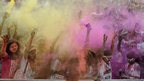 People covered in yellow and purple paint