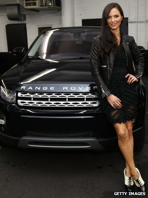 Fashion designer and actor Georgina Chapman pictured with her personalised Range Rover Evoque