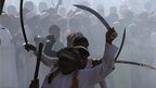Shia Muslims display their skills with swords during a procession in Ajmer, India. Photo: 25 November 2012