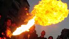 A man spits fire during an Ashura procession in Karachi, Pakistan. Photo: 25 November 2012