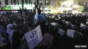 Demonstrators protest in front of Cairo's Supreme Judicial House ahead of the resignation