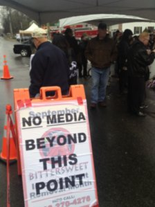 Media hold near the firehouse at Sandy Hook