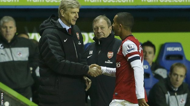 Arsene Wenger and Theo Walcott shake hands as the England player leaves the pitch