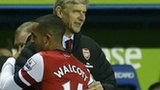 Arsene Wenger and Theo Walcott embrace as the England player leaves the pitch