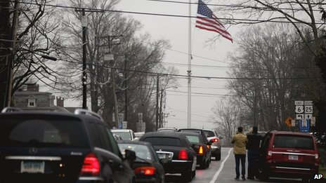 A funeral procession follows the hearse carrying the casket of Sandy Hook Elementary School shooting victim, Jack Pinto, 6, 17 December 2012