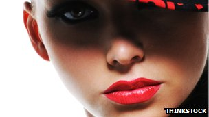 Close-up of a woman wearing red lipstick