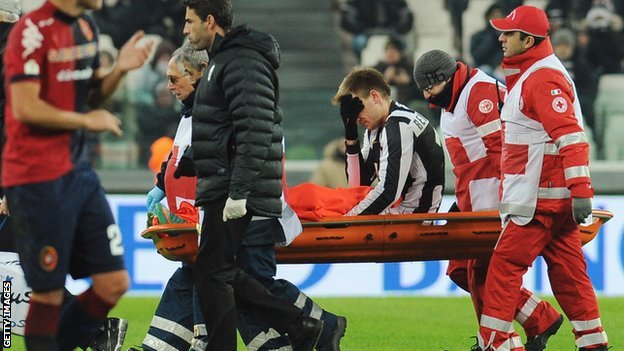 Nicklas Bendtner is carried off on a stretcher