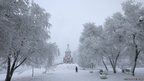 A woman walks past the Orthodox Svyato-Nikolsky church in Russia's Siberian city of Krasnoyarsk