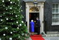 Queen Elizabeth II is greeted by Prime Minister David Cameron as she arrives at No 10 Downing Street