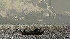 Sun glinting on boat at Hartlepool headland