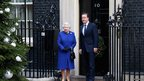 The Queen is greeted by David Cameron at the door of No 10 Downing Street for her historic visit