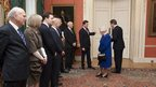 Deputy PM Nick Clegg points the way ahead to the Queen