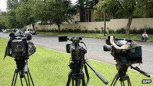 Cameras are set up front of the house of South Africa's former President Nelson Mandela on 14 December 2012 in Houghton, Johannesburg