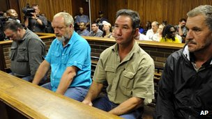 Four men appear in the dock on charges of treason and terrorism at the Bloemfontein Court, South Africa