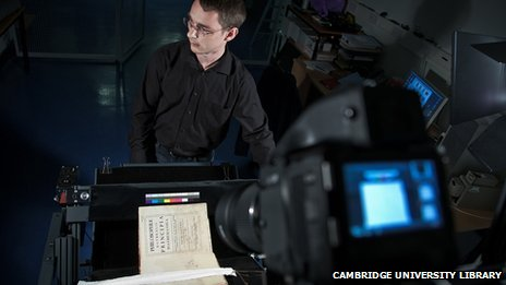 Imaging technician photographing Isaac Newton's Principia for the Cambridge Digital Library