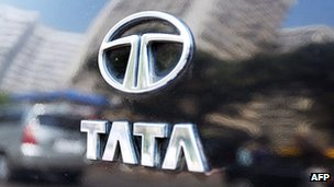 The Tata logo shines on the boot of a car reflecting high-rise buildings of south Mumbai's business district, 31 January 2007.