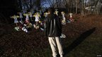 A man looks at a memorial for the 27 victims of a mass shooting in Newtown, Connecticut 18 December 2012