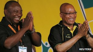 South Africa&#039;s President Jacob Zuma celebrates his re-election as party President alongside newly elected party Deputy President Cyril Ramaphosa (l) at the National Conference of the ruling African National Congress