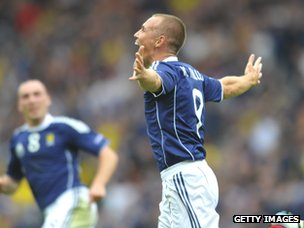 Kenny Miller celebrates scoring Scotland's opening goal during the Euro 2012 qualifying match against Czech Republic at Hampden Park in Glasgow on 3 September 2011