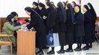 South Korean Catholic nuns queue to cast their votes