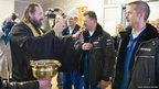 An Orthodox priest blesses the International Space Station crew members (left to right) US astronaut Thomas Marshburn, Russian cosmonaut Roman Romanenko and Canadian astronaut Chris Hadfield before they leave a hotel for a final pre-launch preparation at the Baikonur Cosmodrome