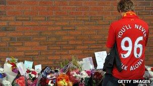 A fan outside Anfield