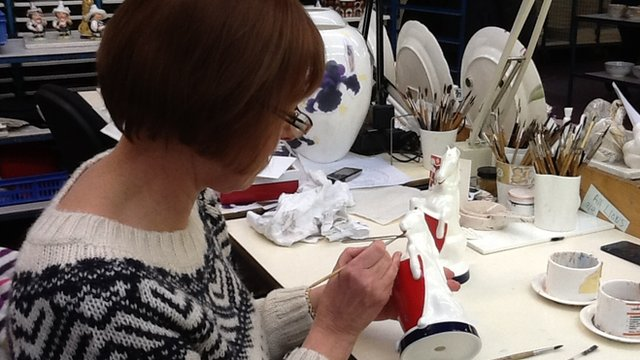 Jackie Morrison painting a unicorn for the Queen's Diamond Jubilee