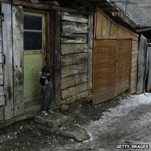 A Roma child stands in the doorway of a shack in Slovakia