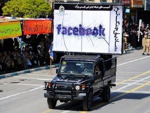 A security vehicle carries a poster denouncing Facebook at a military parade in Iran in 2011