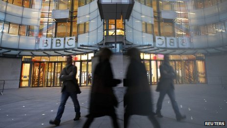 People walk outside the BBC's News Broadcasting House on the day the Pollard Review was published