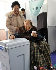 An elderly woman casts her ballot in Nonsan, South Korea, on 19 December 2012