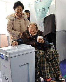 An elderly woman casts her ballot in Nonsan, South Korea, on 19 December 2012