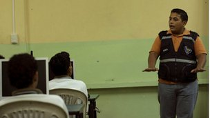 Police officer giving a talk in a Guayquil high schools