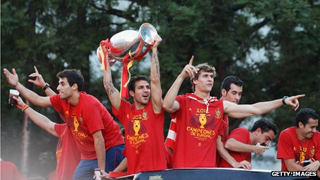 Cesc Fabregas holds aloft the Euro 2012 trophy in Madrid