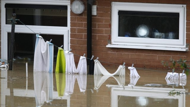 Washing line in floodwater
