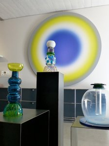 Glassware from the Memphis group, displayed in front of  work by Ugo Rondinone, at Simon Studer's gallery